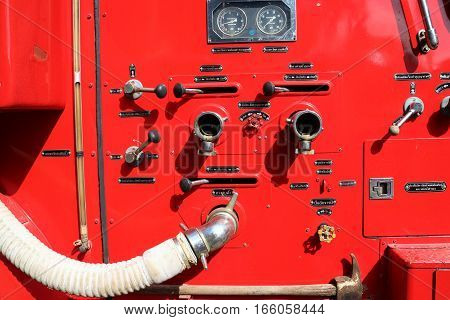 Fire hose and other equipment in a truck, fire water hose connector on board a fire engine