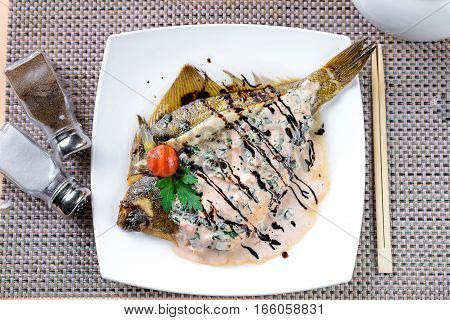 Fried Flounder on plate decorated in Asian style