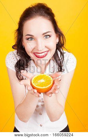 happy girl shows orange yellow orange