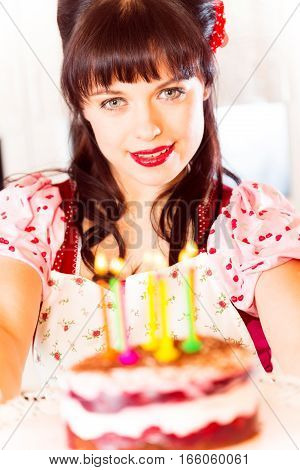 Young in vintage style dress with birthday cake