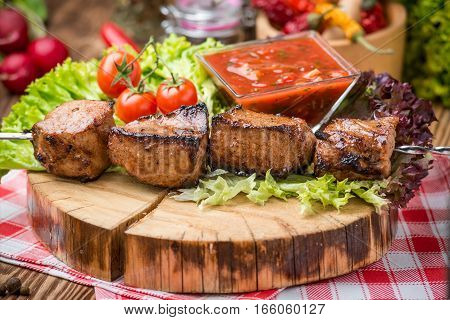 Delicious juicy skewered meat or shish kebabs on skewers of pork tenderloin. Fragrant and spicy dish.