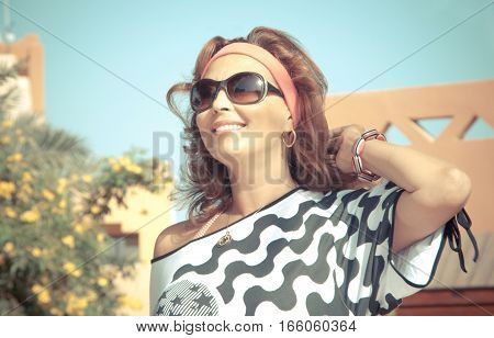 Closeup portrait of elegant middle aged woman