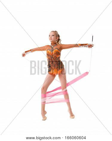 Pretty blonde girl in artistic embroidered yellow sportsuit exercising with a gymnastic pink ribbon studio shot