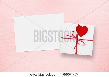 Blank Valentines Day card and gift box on pink background