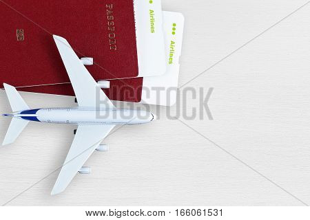 Boarding passes passports and toy plane on table