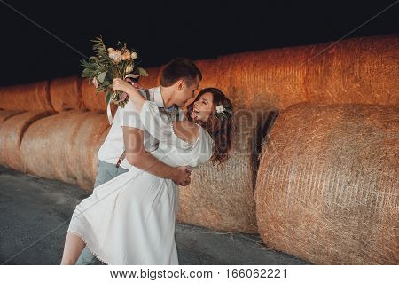 Bride and groom on background of hay