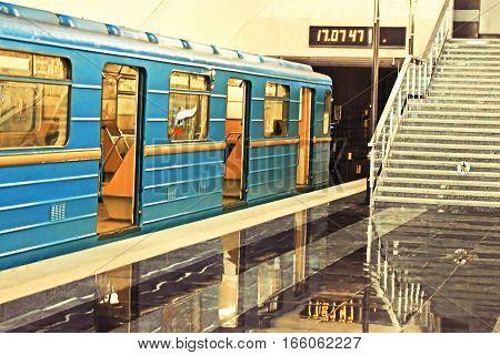 Subway station with blue vagon in Kyiv underground, Ukraine