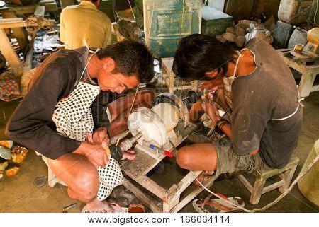 MANDALAY MYANMARMAY - 19 January 2010: People processing of semi-precious stones on a factory of Mandaley Myanmar