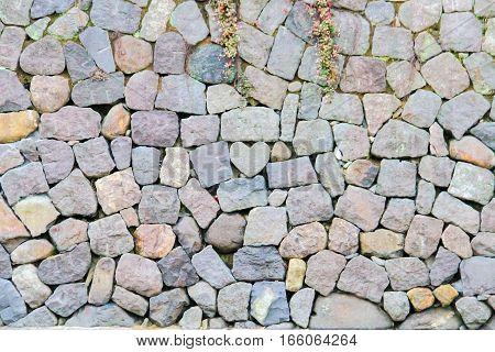 rock heart shape in stone wall at Megane Spectacles Bridge in Nagasaki prefecture Kyushu region Japan
