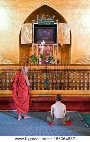 MANDALAY MYANMARMAY - 19 January 2010: People praying at Mahamuni Buddha temple in Mandalay Myanmar.