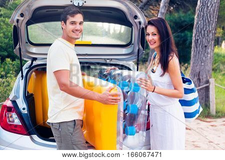 young couple going to the beach, enjoying her summer holidays.