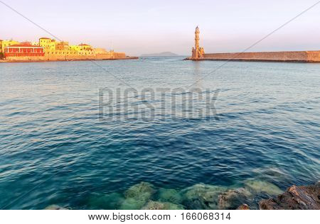 Lighthouse in the old harbor of Chania at dawn. Crete. Greece.