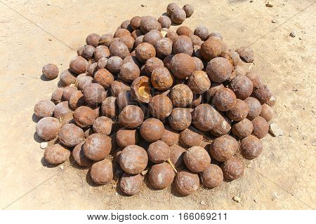 Rethymnon Island Crete Greece - June 23 2016: Stack of old rusty colonial cannon balls on historic military fort walls in Fortezza Castle in Rethymnon
