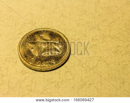 Coin One Latvian Lat With A Bell On Light Background