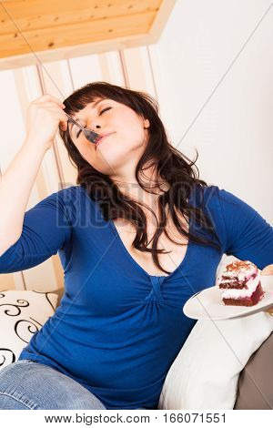 young woman enjoying a piece of cake