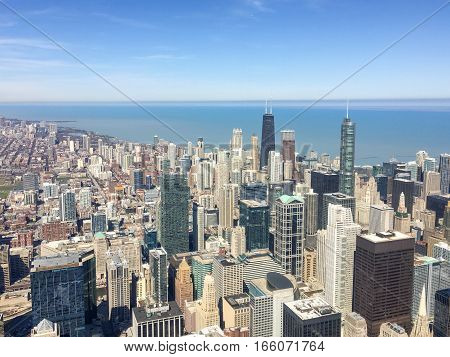 amazing chicago city scene, which has a lot of buildings, blue sky and lake michigan