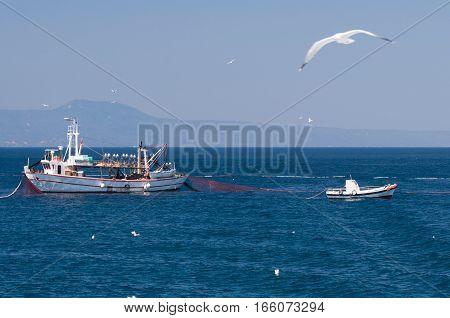 Trawler Spreading Fishing Net