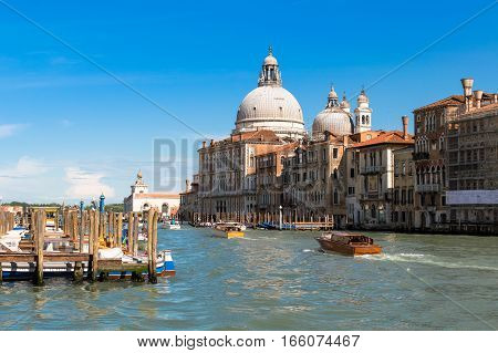 Venice - Italy April 26 - 2014 : view of Grand Canal with the dome of the basilica of Santa Maria della Salute