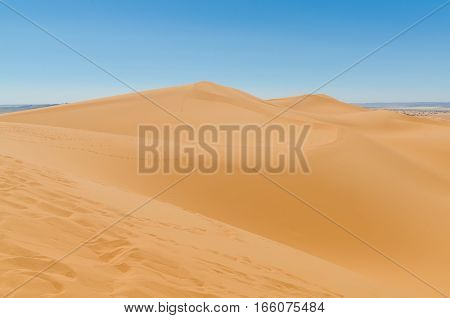 Famous and inconic sahara sand dunes of Erg Chebbi in the Moroccan desert near Merzouga, Morocco, North Africa.