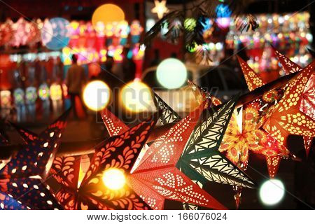 An abstract view of the Diwali street in Pune India which is full of beautiful traditional lantern shops for the festival.