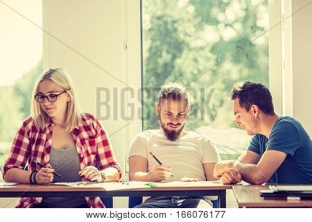 Education concept. Highschool students having fun during a break in classroom interior