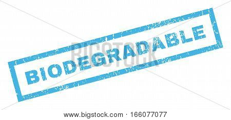 Biodegradable text rubber seal stamp watermark. Tag inside rectangular banner with grunge design and scratched texture. Inclined vector blue ink sticker on a white background.
