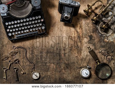 Antique typewriter vintage items and photo camera. Flat lay still life