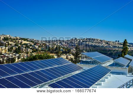 solar panels on the background of the city of Jerusalem