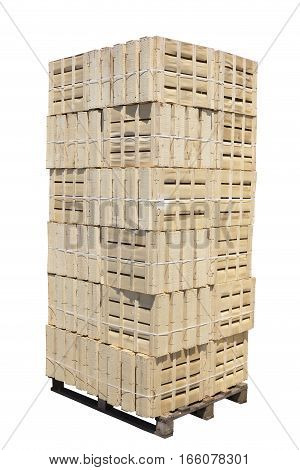 pallet with stacked wooden crates isolated on white
