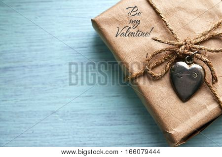 Valentines Day gift with silver heart on a blue wooden background.Valentine's Day background.Saint Valentine's Day or Love concept.Selective focus.