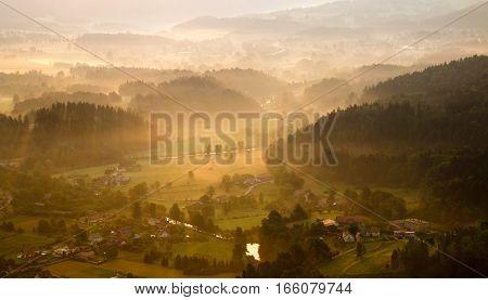 Misty sunrise at Rudawy Janowickie Mountains Poland