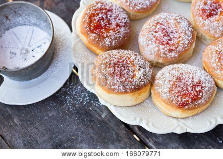 donut and powdered sugar on dark background