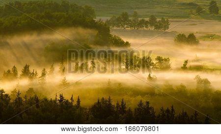 Misty sunrise at Rudawy Janowickie meadows Poland