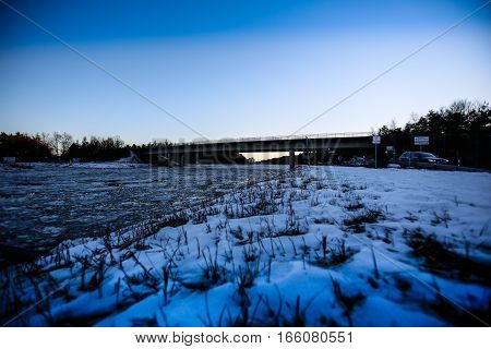 The partly frozen and icy Main-Donau Canal in Germany near Erlangen