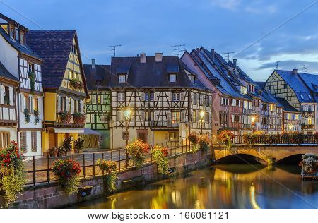 Embankment of Lauch River with historical houses in Colmar Alsace France. Evening