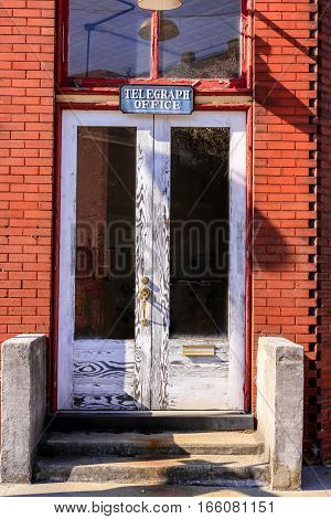 The closed doors of the Telegraph Office in downtown Canton North Carolina