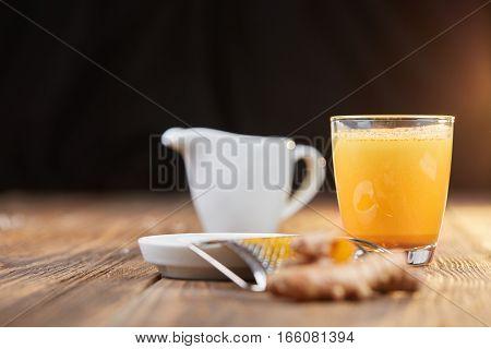 Turmeric Curcuma Drink With Roots On Table