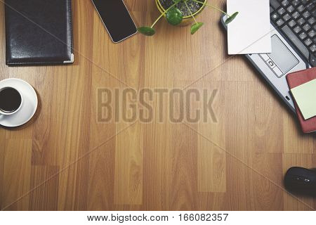 Office workplace with laptop notepad coffee of cup and smartphone on wood table