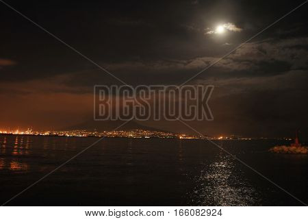 Night sea landscape of the Bay of Naples in case of moonlight.