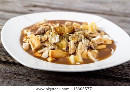chicken poutine quebec cuisine made with gravy fried cheese curd and chicken