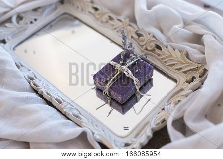 Lavender violet soap tied with thread on mirror tray