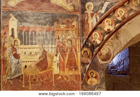 MTSKHETA, GEORGIA - OCT 13, 2016: Jesus heals a sick man on ancient fresco of Svetitskhoveli Cathedral on October 13, 2016. Cathedral was built in 4th century. UNESCO World Heritage Site.