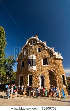 Barcelona, Spain - September 20, 2014: Park Guell by architect Antoni Gaudi in Barcelona, Catalonia, Spain. Pavilion at the entrance of the park.