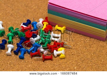 Group Of Colorful Push Pins On Cork Board