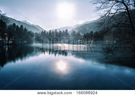 Blue lake with fog and water reflection at mountain background. Caucasus Kabardino-Balkaria Russia
