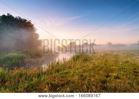 Summer Misty Sunrise On The River. Foggy River In The Morning. Summer Misty Dawn