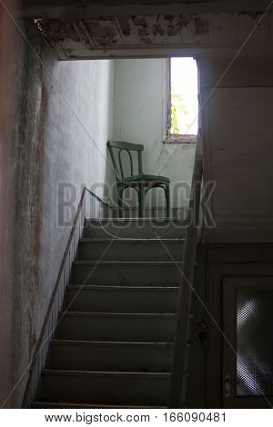 Stairs and chairs in the abandoned building