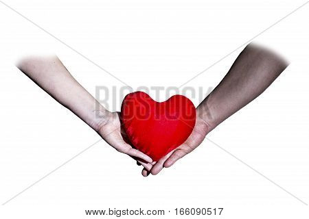 Male and female hands holding a heart on white background Valentine's Day