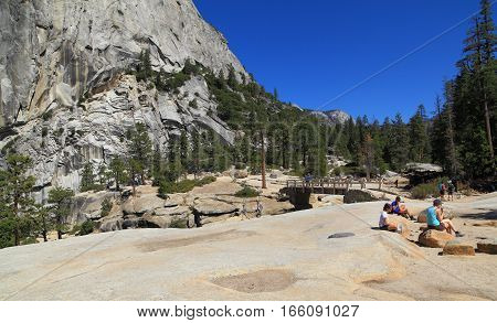 YOSEMITE NATIONAL PARK - SEP 22: Hikers gather at the top of Nevada Falls near the base of Liberty Cap on Sep 22, 2015 in Yosemite National Park. Nevada Falls is located at the west end of Little Yosemite Valley.