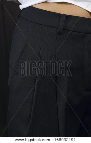 Macro detail of fashion clothes - black pants